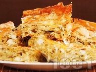 Рецепта Мързелива баница от готови одрински кори с праз лук, яйца и сирене